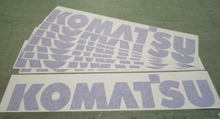 Komatsu kirjaimet siirtokalvolla