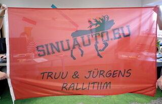 Mainoslippu Truu ja Jürgens rallitiim